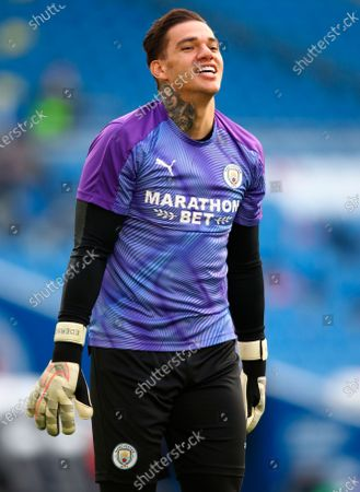 Image libre de droits de Manchester City goalkeeper Ederson smiles during the warm-up before the English Premier League match between Brighton & Hove Albion and Manchester City in Brighton, Britain, 11 July 2020.