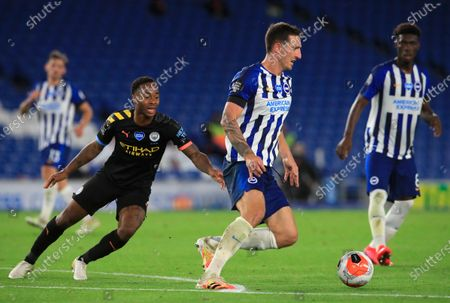 Brighton's Lewis Dunk (R) in action against Manchester City's Raheem Sterling (L) during the English Premier League match between Brighton & Hove Albion and Manchester City in Brighton, Britain, 11 July 2020.