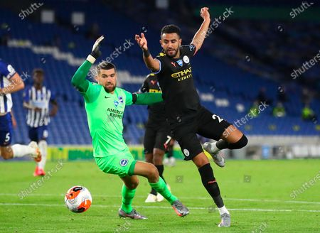 Manchester City's Riyad Mahrez (R) in action against Brighton's goalkeeper Mat Ryan (L) during the English Premier League match between Brighton & Hove Albion and Manchester City in Brighton, Britain, 11 July 2020.