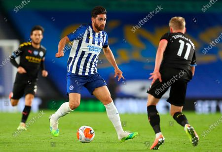 Brighton's Alireza Jahanbakhsh (L) in action against Manchester City's Oleksandr Zinchenko (R) during the English Premier League match between Brighton & Hove Albion and Manchester City in Brighton, Britain, 11 July 2020.