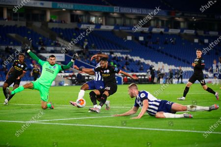Manchester City's Riyad Mahrez (C) in action against Brighton's goalkeeper Mat Ryan (L) during the English Premier League match between Brighton & Hove Albion and Manchester City in Brighton, Britain, 11 July 2020.