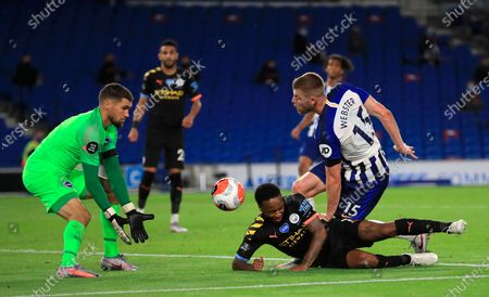 Manchester City's Raheem Sterling (C) scores for a 5-0 lead during the English Premier League match between Brighton & Hove Albion and Manchester City in Brighton, Britain, 11 July 2020.