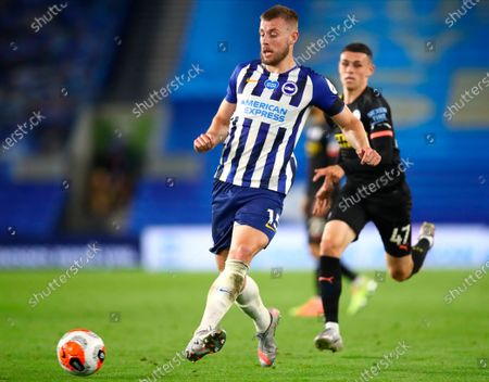 Brighton's Adam Webster (L) in action against Manchester City's Phil Foden (R) during the English Premier League match between Brighton & Hove Albion and Manchester City in Brighton, Britain, 11 July 2020.