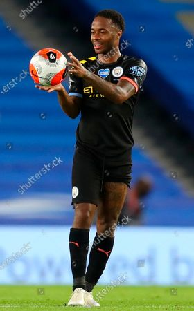 Manchester City's Raheem Sterling catches the ball after the English Premier League match between Brighton & Hove Albion and Manchester City in Brighton, Britain, 11 July 2020.