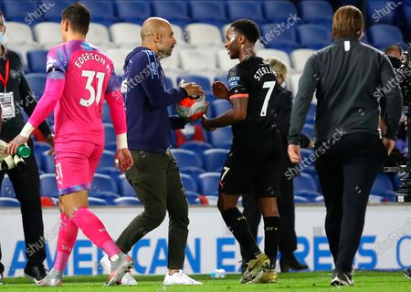Manchester City's Raheem Sterling (C-R) talks to Manchester City manager Pep Guardiola (C-L) after the English Premier League match between Brighton & Hove Albion and Manchester City in Brighton, Britain, 11 July 2020.