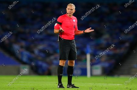 Referee Graham Scott gestures during the English Premier League match between Brighton & Hove Albion and Manchester City in Brighton, Britain, 11 July 2020.