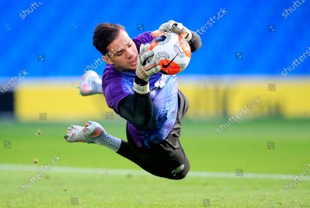 Manchester City goalkeeper Ederson in action during warm-up before the English Premier League match between Brighton & Hove Albion and Manchester City in Brighton, Britain, 11 July 2020.