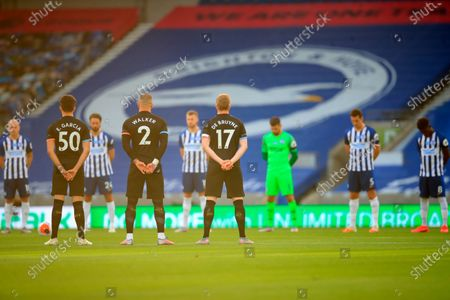 Players observe a minute of silence to remember former English international Jack Charlton before the English Premier League match between Brighton & Hove Albion and Manchester City in Brighton, Britain, 11 July 2020.