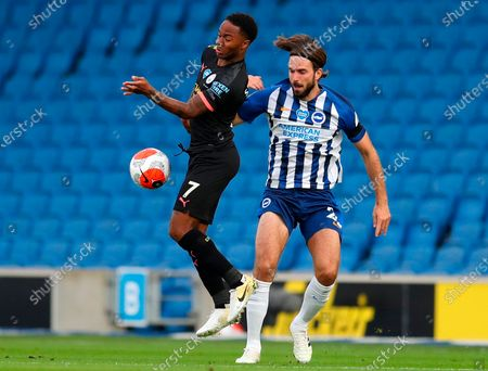 Manchester City's Raheem Sterling (L) in action against Brighton's Davy Propper (R) during the English Premier League match between Brighton & Hove Albion and Manchester City in Brighton, Britain, 11 July 2020.