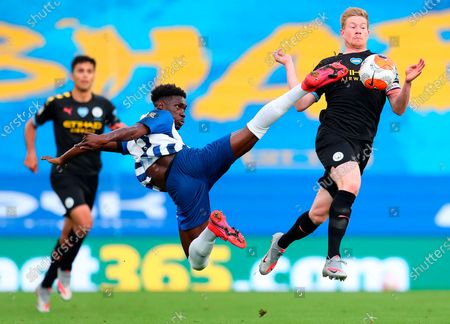 Brighton's Yves Bissouma (L) in action against Manchester City's Kevin De Bruyne (R) during the English Premier League match between Brighton & Hove Albion and Manchester City in Brighton, Britain, 11 July 2020.