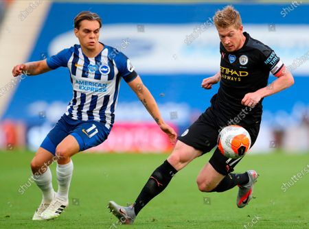 Manchester City's Kevin De Bruyne (R) in action against Brighton's Leandro Trossard (L) during the English Premier League match between Brighton & Hove Albion and Manchester City in Brighton, Britain, 11 July 2020.