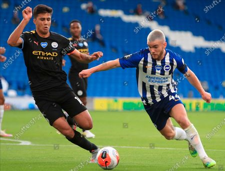 Brighton's Aaron Connolly (R) in action against Manchester City's Rodrigo (L) during the English Premier League match between Brighton & Hove Albion and Manchester City in Brighton, Britain, 11 July 2020.