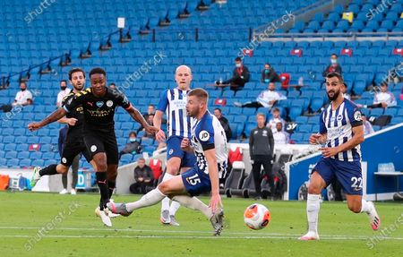 Manchester City's Raheem Sterling (L) scores the 1-0 lead during the English Premier League match between Brighton & Hove Albion and Manchester City in Brighton, Britain, 11 July 2020.