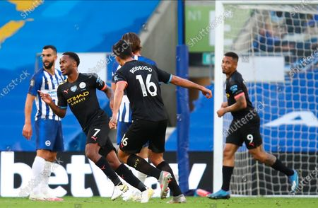 Manchester City's Raheem Sterling (2-L) celebrates scoring the 1-0 lead during the English Premier League match between Brighton & Hove Albion and Manchester City in Brighton, Britain, 11 July 2020.