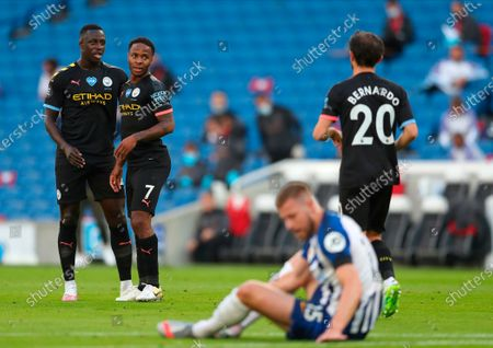 Manchester City's Raheem Sterling (R) celebrates after scoring the 1-0 lead with Manchester City's Benjamin Mendy (L) during the English Premier League match between Brighton & Hove Albion and Manchester City in Brighton, Britain, 11 July 2020.