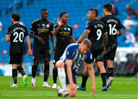 Manchester City's Raheem Sterling (C) celebrates with teammates after scoring the 1-0 lead during the English Premier League match between Brighton & Hove Albion and Manchester City in Brighton, Britain, 11 July 2020.