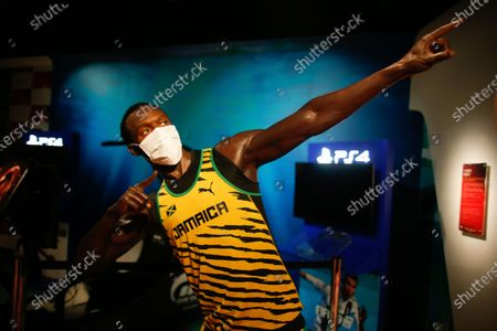 In order to raise awareness against the spread of the coronavirus, a mask is placed on the wax figure of Jamaica's Usain Bolt at Madame Tussauds attraction in Istanbul, . Turkish authorities have made the wearing of masks mandatory in most of the country to curb the spread of COVID-19 following an uptick in confirmed cases since the reopening of many businesses