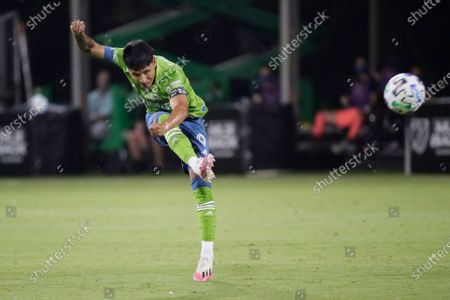 Seattle Sounders forward Raul Ruidiaz takes a shot against the San Jose Earthquakes during the first half of an MLS soccer match, in Kissimmee, Fla