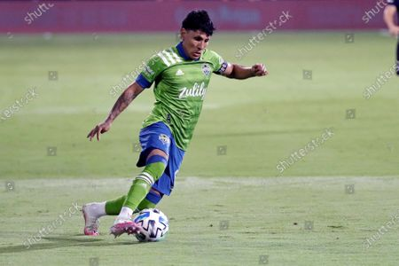 Seattle Sounders forward Raul Ruidiaz moves the ball against the San Jose Earthquakes during the first half of an MLS soccer match, in Kissimmee, Fla