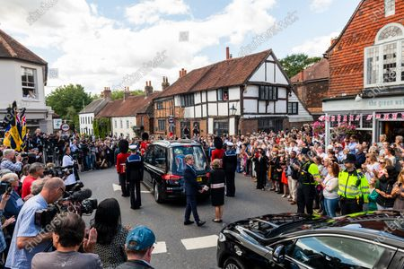 "The village where forces' sweetheart Dame Vera Lynn lived until her death at the ripe old age of 103 years, came to a standstill this afternoon as residents and friends saluted her cortege as it made its final journey to Woodvale Crematorium in Brighton.  Police closed off roads in Ditchling, East Sussex  to allow the funeral procession to stop so that residents could say a final goodbye to Dame Vera, whose song ""We'll meet again"" was one of her best remembered.  A Battle of Britain flypast coincided with the brief stop-over during the funeral procession."