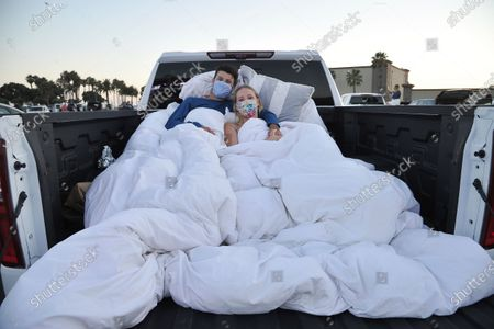 """Bailey Lorcher, left, and Evan Heffernan, from Calabasas, California, attend """"Concerts In Your Car,"""", at the Ventura County Fairgrounds in Ventura, Calif"""