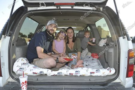 The Fulkerson family from Somis, California, attend Concerts In Your Car, at the Ventura County Fairgrounds in Ventura, Calif