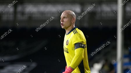 Atlanta United goalkeeper Brad Guzan (1) reacts to a play during an MLS soccer match against the New York Red Bulls, in Kissimmee, Fla