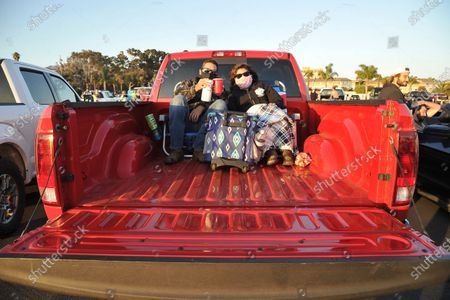Fans relax before the show at Concerts In Your Car, at the Ventura County Fairgrounds in Ventura, Calif