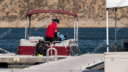Diver Tim Coates of the Ventura County Sheriff Dive Team after a difficult windy search day