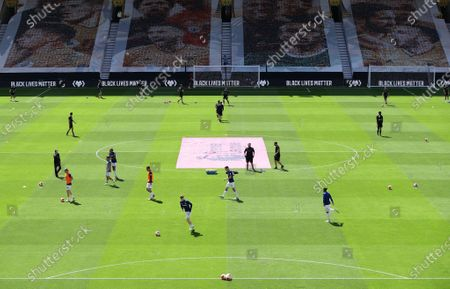 Wolverhampton Wanderers and Everton players warm up prior the English Premier League match between Wolverhampton Wanderers and Everton at Molineux Stadium, in Wolverhampton, Britain, 12 July 2020.