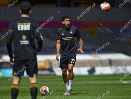 Wolverhampton Wanderers' Morgan Gibbs-White (R) warms up prior to English Premier League match between Wolverhampton Wanderers and Everton in Wolverhampton, Britain, 12 July 2020.