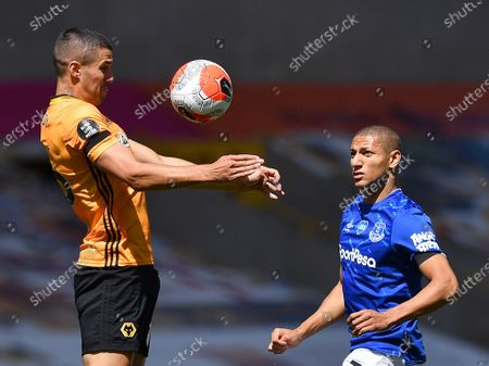 Wolverhampton Wanderers' Conor Coady (L) in action against Everton's Richarlison (R) during the English Premier League soccer match between Wolverhampton Wanderers and Everton in Wolverhampton, Britain, 12 July 2020.