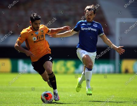 Wolverhampton Wanderers' Pedro Neto (L) in action against Everton's Leighton Banes (R) during the English Premier League soccer match between Wolverhampton Wanderers and Everton in Wolverhampton, Britain, 12 July 2020.
