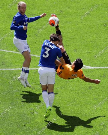 Wolverhampton Wanderers' Raul Jimenez (R) in action against Everton's Leighton Baines (C) and Tom Davies (L) during the English Premier League soccer match between Wolverhampton Wanderers and Everton in Wolverhampton, Britain, 12 July 2020.