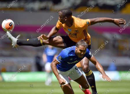 Wolverhampton Wanderers Willy Boly (top) in action against Everton's Dominic Calvert-Lewin (bottom) during the English Premier League soccer match between Wolverhampton Wanderers and Everton in Wolverhampton, Britain, 12 July 2020.