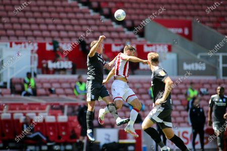 Sam Vokes of Stoke City (9) gets up for a header during the EFL Sky Bet Championship match between Stoke City and Birmingham City at the Bet365 Stadium, Stoke-on-Trent