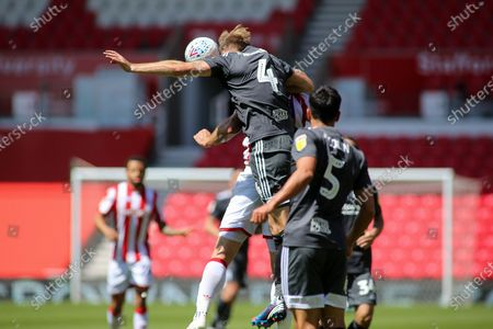 Marc Roberts of Birmingham City (4) wins a header during the EFL Sky Bet Championship match between Stoke City and Birmingham City at the Bet365 Stadium, Stoke-on-Trent