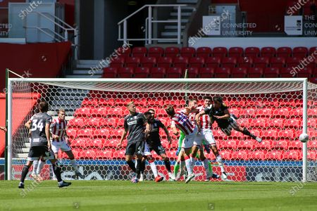 Lukas Jutkiewicz of Birmingham City (10) hurls himself at a corner in an attempt to score during the EFL Sky Bet Championship match between Stoke City and Birmingham City at the Bet365 Stadium, Stoke-on-Trent