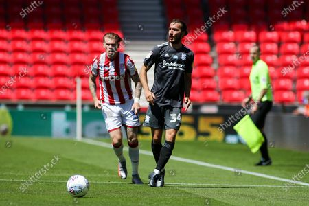 Ivan Sunjic of Birmingham City (34) and James McClean of Stoke City (11) during the EFL Sky Bet Championship match between Stoke City and Birmingham City at the Bet365 Stadium, Stoke-on-Trent
