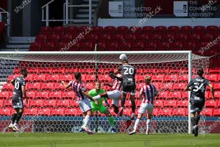 Gary Gardner of Birmingham City (20) gets a header on target during the EFL Sky Bet Championship match between Stoke City and Birmingham City at the Bet365 Stadium, Stoke-on-Trent