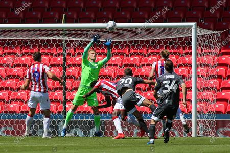 Gary Gardner of Birmingham City (20) gets a header on target saved by Adam Davies of Stoke City (16) during the EFL Sky Bet Championship match between Stoke City and Birmingham City at the Bet365 Stadium, Stoke-on-Trent