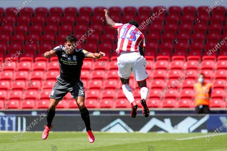 Bruno Martins Indi of Stoke City (15) and Maxime Colin of Birmingham City (5) challenge for a high ball during the EFL Sky Bet Championship match between Stoke City and Birmingham City at the Bet365 Stadium, Stoke-on-Trent