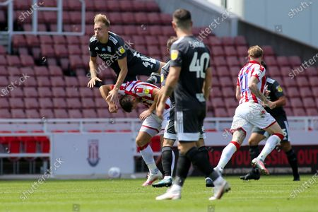 Marc Roberts of Birmingham City (4) climbs all over Sam Vokes of Stoke City (9) during the EFL Sky Bet Championship match between Stoke City and Birmingham City at the Bet365 Stadium, Stoke-on-Trent