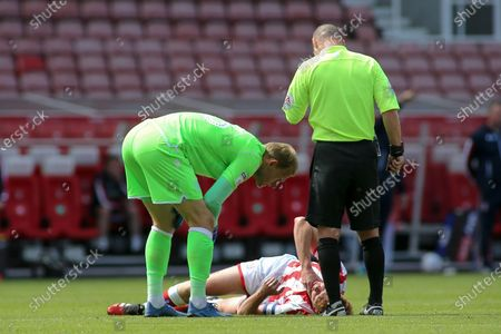 Adam Davies of Stoke City (16) looks concerned about Sam Clucas of Stoke City (22) during the EFL Sky Bet Championship match between Stoke City and Birmingham City at the Bet365 Stadium, Stoke-on-Trent