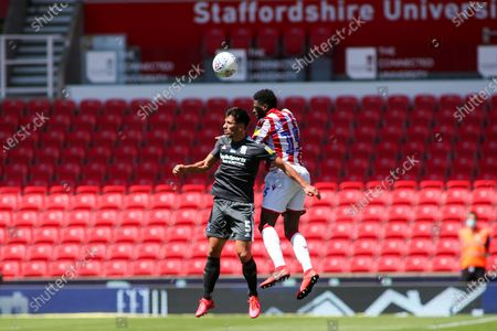Bruno Martins Indi of Stoke City (15) wins a header against Maxime Colin of Birmingham City (5) during the EFL Sky Bet Championship match between Stoke City and Birmingham City at the Bet365 Stadium, Stoke-on-Trent