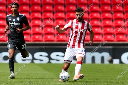 Tommy Smith of Stoke City (14) chased by Jude Bellingham of Birmingham City (22) during the EFL Sky Bet Championship match between Stoke City and Birmingham City at the Bet365 Stadium, Stoke-on-Trent