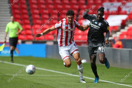 Danny Batth of Stoke City (6) and Jayden Reid of Birmingham City (49) battle for the ball  during the EFL Sky Bet Championship match between Stoke City and Birmingham City at the Bet365 Stadium, Stoke-on-Trent