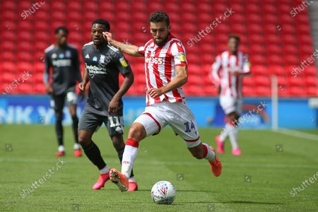 Tommy Smith of Stoke City (14) crosses the ball during the EFL Sky Bet Championship match between Stoke City and Birmingham City at the Bet365 Stadium, Stoke-on-Trent
