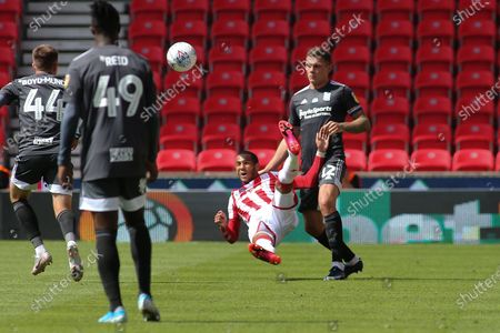 Thomas Ince of Stoke City (7) is fouled by Harlee Dean of Birmingham City (12) during the EFL Sky Bet Championship match between Stoke City and Birmingham City at the Bet365 Stadium, Stoke-on-Trent