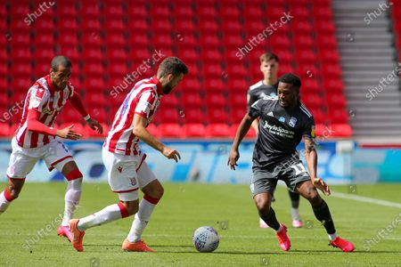Jérémie Bela of Birmingham City (11) takes on Tommy Smith of Stoke City (14) during the EFL Sky Bet Championship match between Stoke City and Birmingham City at the Bet365 Stadium, Stoke-on-Trent
